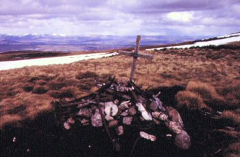 Small pile of wreckage and memorial cross